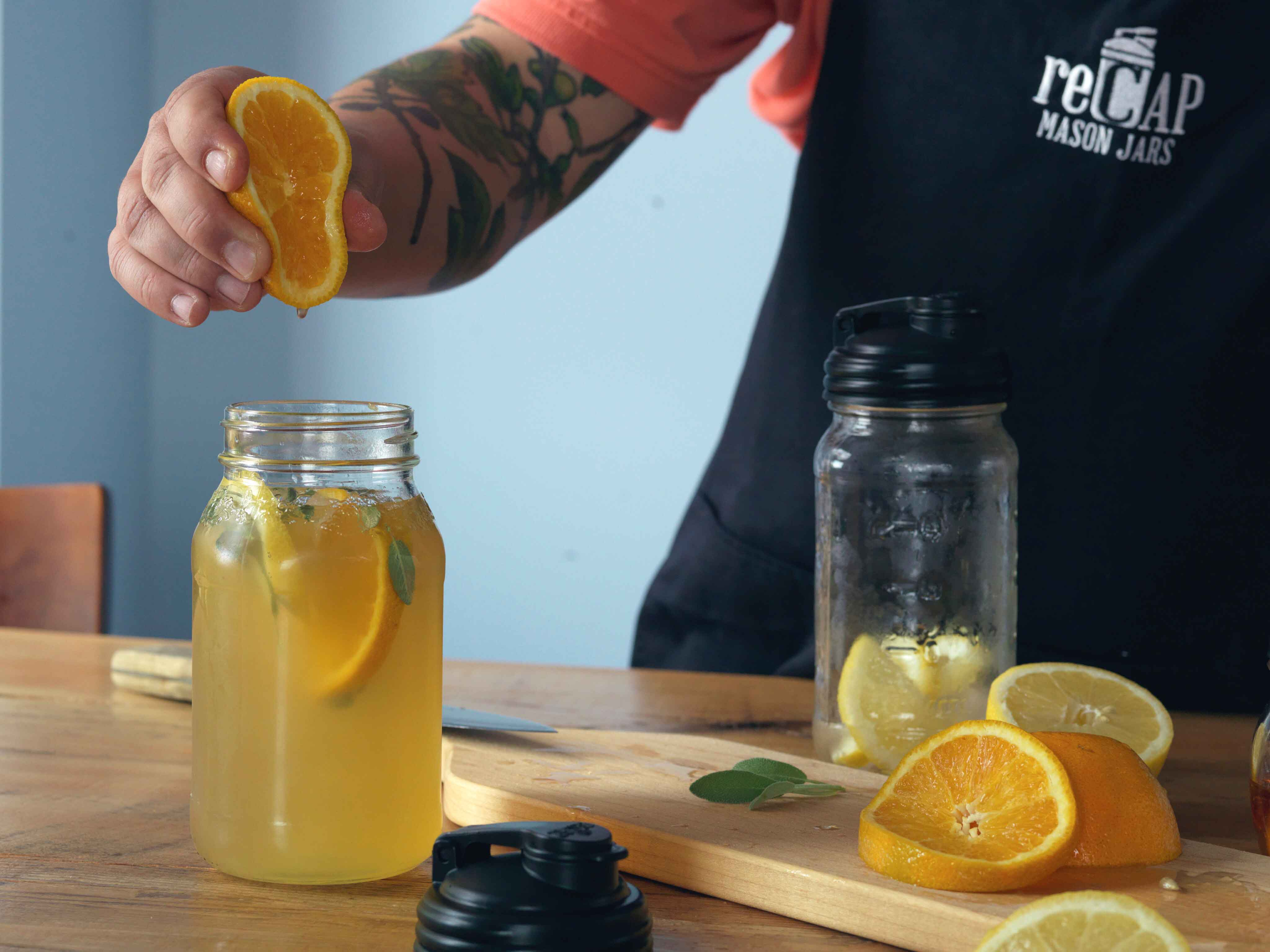 Squeezing Orange Juice into Jar