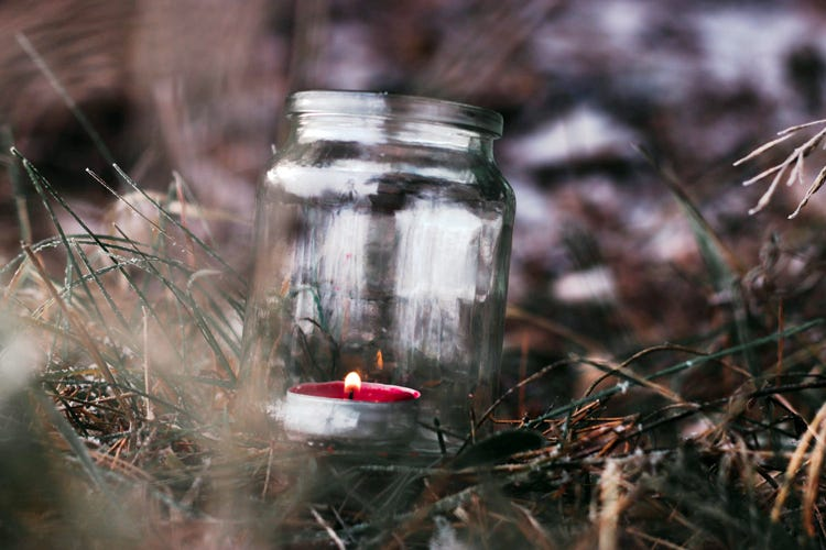 Red candle in a Mason jar
