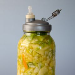 An easy fermentation recipe for beginners! Learn how to make this Apple, Ginger, and Citrus Sauerkraut in a Mason Jar.
