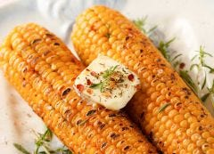 Corn on the cob with spices and butter