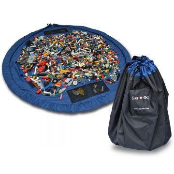 """The Lay-n-Go® LARGE (60"""") is a patented high-quality activity play mat that allows for quick and effortless clean-up of small toy pieces. No more dumping bins and baskets.  The patented raised lip keeps Lego® and other toys contained on the play surface."""