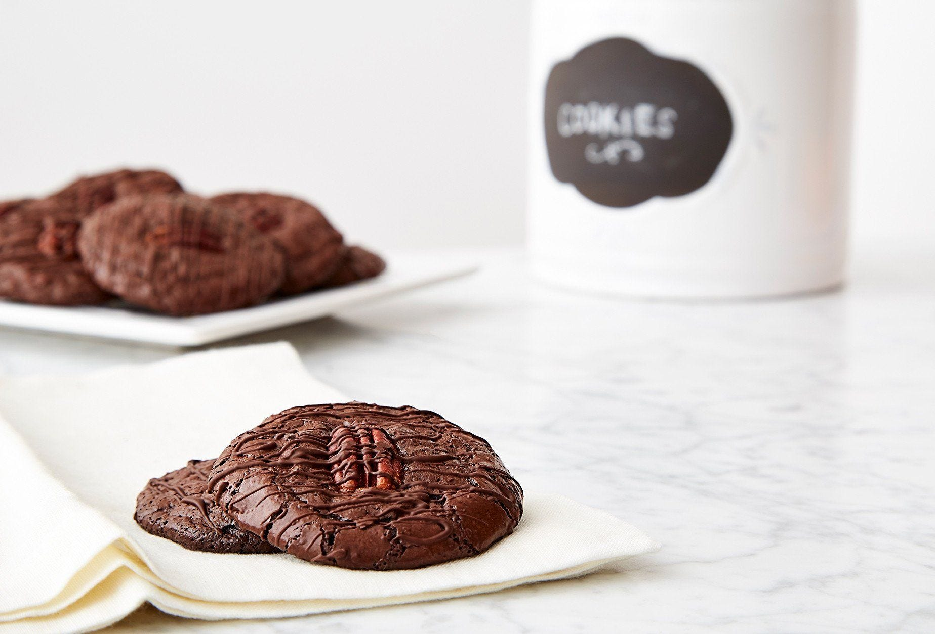 Flourless Chocolate Pecan Cookies with Chocolate Drizzle recipe.