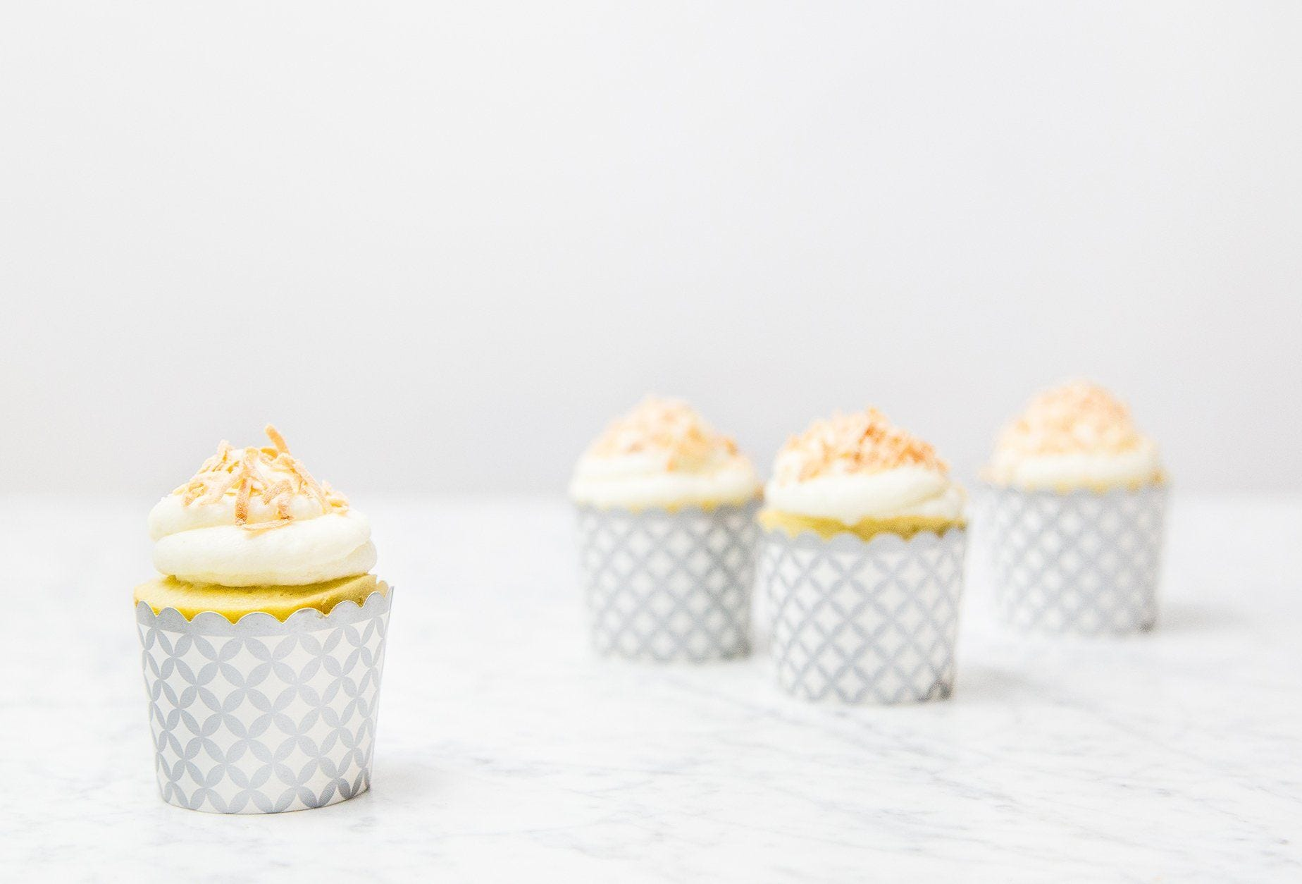 Coconut Cupcakes with Toasted Flakes recipe.